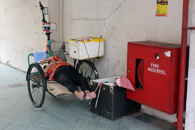 Lady taking a nap, Chinatown.