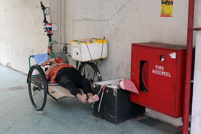 Lady taking a nap, Chinatown.