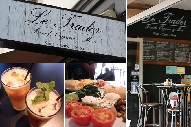 Le Trader sign, cafe stools, fresh juices, and vegetarian brekkie.