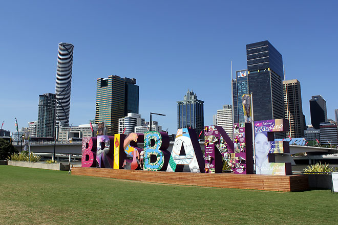 "Colourful installation of the word, ""Brisbane"" with the high rises as backdrop."