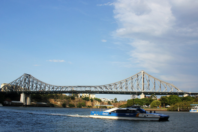 Story bridge, City Cat ferry, and an overcast.