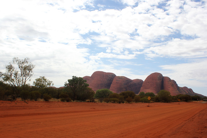 Kata Tjuta in the distance, red road foreground.