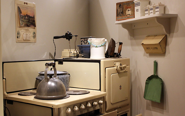 stovetop with kettle, dustpan, etc.