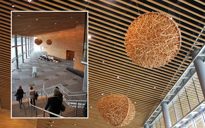 Hanging from the ceiling, these wooden acorn sculptures