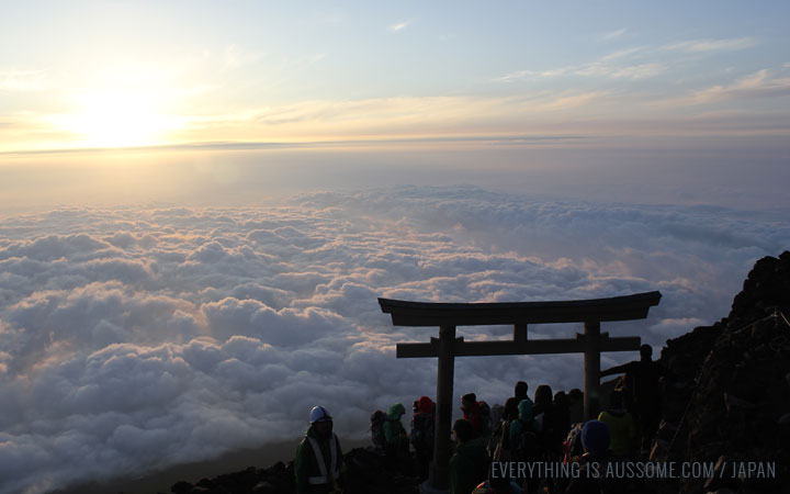View from Mt Fuji, sun rise. Torii gates takes the foreground.