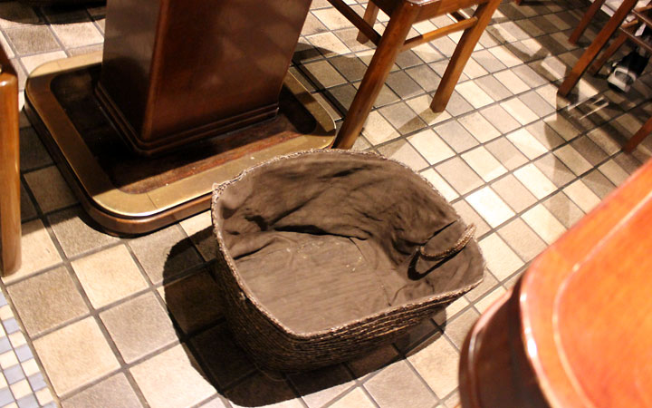 Japanese customs include putting your belongings in a basket beside the table when eating out.