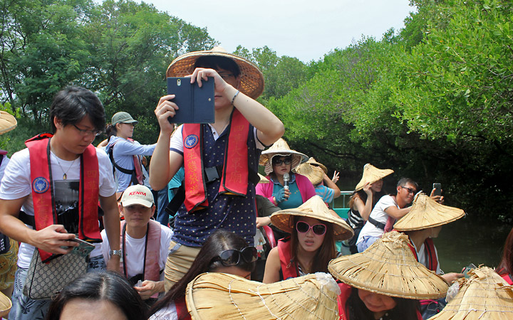 People with straw hats on the boat