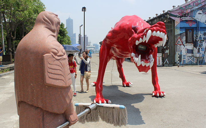 From a different angle, we see the red monsters' teeth and the man holding a mop.